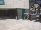 Гранит на фасадную отделку в формате модульной плиты. Элементы мозаичного панно